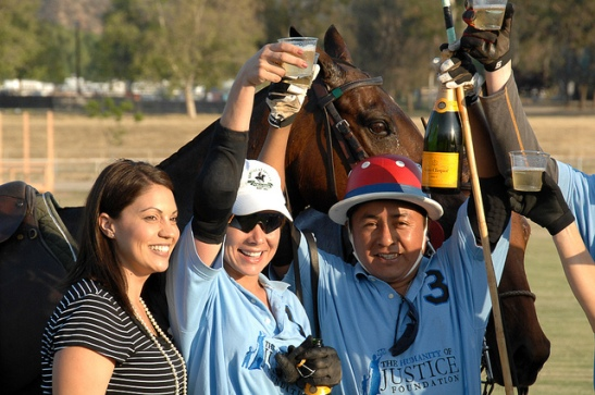 Geraldine Strunsky (center,) and Alfredo Tedeo celebrate Humanity of Justice Foundation's Polo Team Win