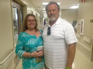 New Temecula residents, John Meddis and wife Claudia view patient rooms.