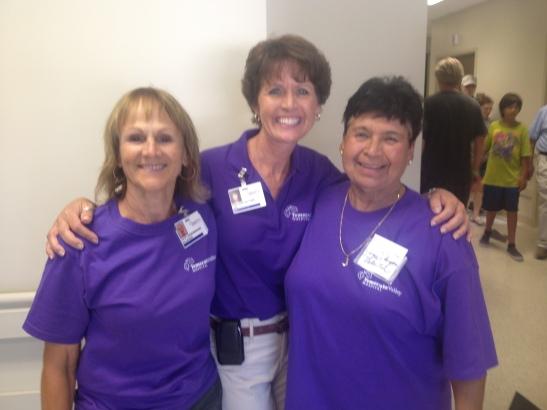 CEO Darlene Wetton (center) with volunteers Julie Landenberger (L) and Joyce Reyes (R)