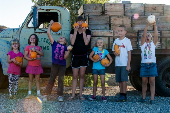 Kids and pumpkins at Peltzer Farms (c) Crispin Courtenay