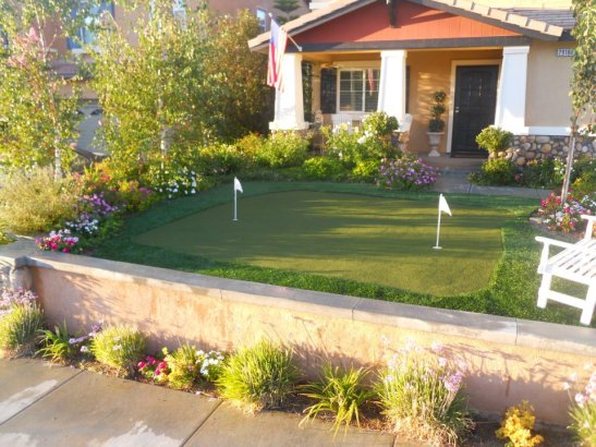Raised putting green provides entertainment, as well as water-wise use of space in this backyard.