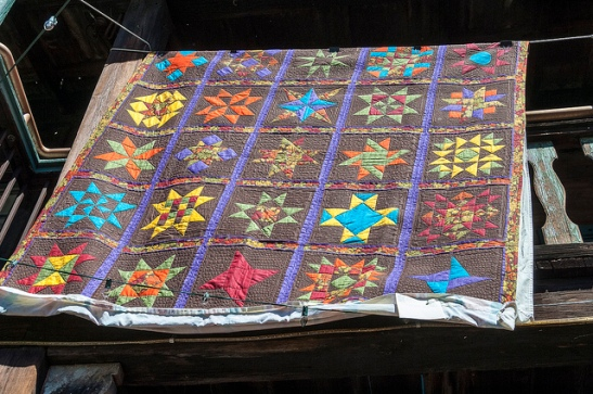 Quilts draped all over old town Temecula (c) Crispin Courtenay