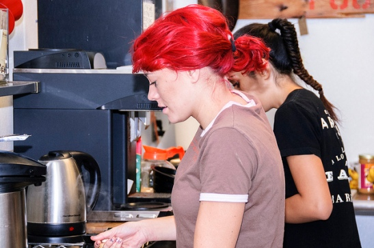 Workers at E.A.T. preparing menu items for the day in Temecula E.A.T. kitchen (c) Crispin Courtenay