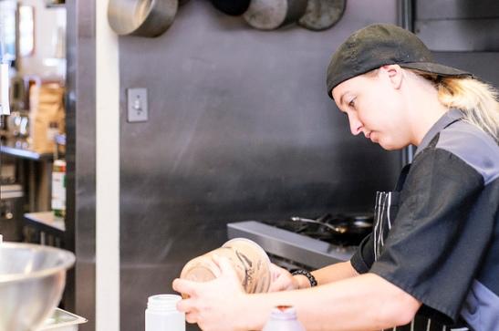 E.A.T. Kitchen staffer (c) Crispin Courtenay