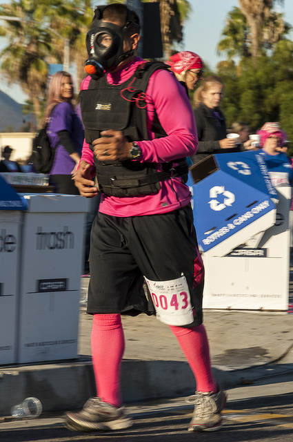 Gas mask wearing runner Susan G. Komen Race for the cure in Temecula (c) Crispin Courtenay