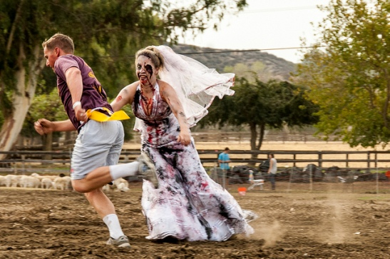 Zombie bride grabs her victim at Boojum Zombie Fun Run in Temecula (c) Crispin Courtenay