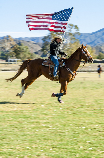 America the beautiful John Wayne style on horseback at American Flag Horses at end of season 2013 Temecula Valley Polo Club (c) Crispin Courtenay