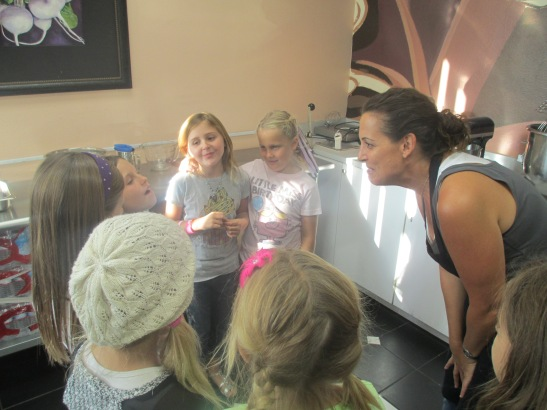 Andrea Maue educates and teaches girls about baking and kitchen cleanliness, safety and fun!