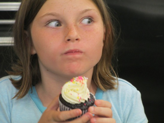 First bite of her creation, equals cupcake decorating bliss.