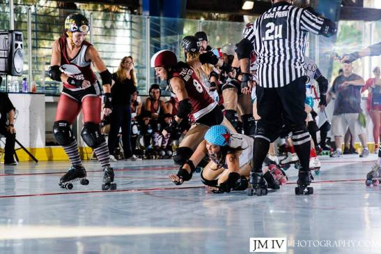 """""""Tutto Brutto"""" hitting hard at Roller Derby Bout (courtesy)"""