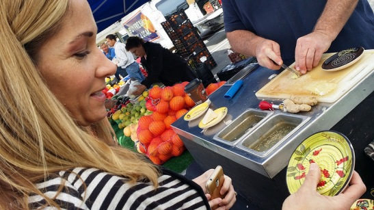 Chef Monica Rigali watching garlic demonstration at Temecula Farmer's Market Promenade Mall (Ashley Ludwig)