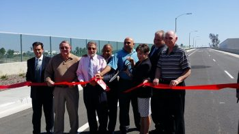 One, two, three! Mayor Maryann Edwards of Temecula cuts the ribbon for the French Valley Interchange of I15 into Murrieta