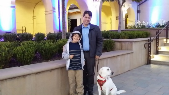 Special needs family, with assistance dog watching the colors in Temecula