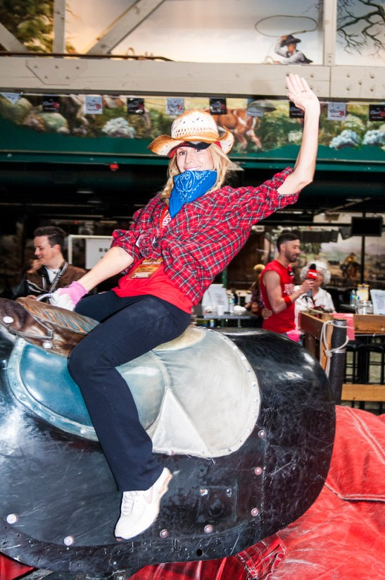 Riding the bull at Stampede is a staple of the Reality Rally obstacles (c) Crispin Courtenay