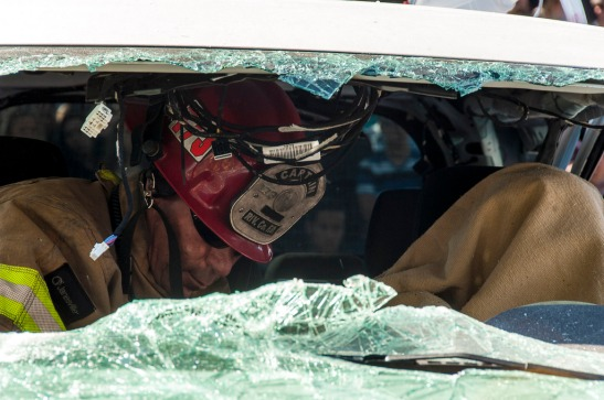 A mock-deceased victim in the car as Cal Fire Fighter works to free passengers (c) Crispin Courtenay