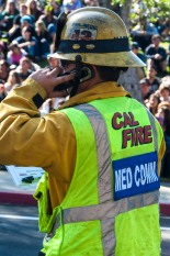 Cal Fire medic relays grim details of accident scene while onlookers observe (c) Crispin Courtenay