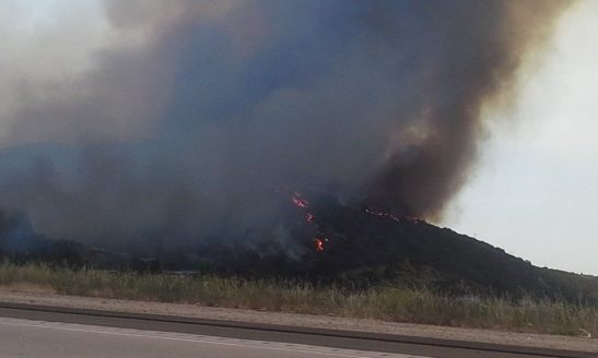 Flames from a wildfire burning in the Fallbrook area are pictured from southbound Interstate 15 just south of Highway 76 in northern San Diego County, May 14, 2014. Photo/Belinda Callin