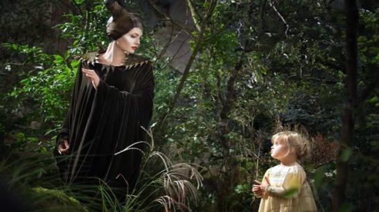 Maleficent meets Aurora (Briar Rose) in a magical setting.