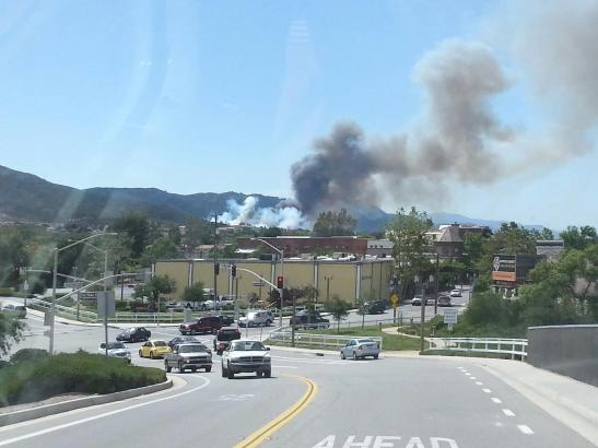 Fire on the mountain - west of Old Town Temecula, a brushfire rages as CalFire on scene.